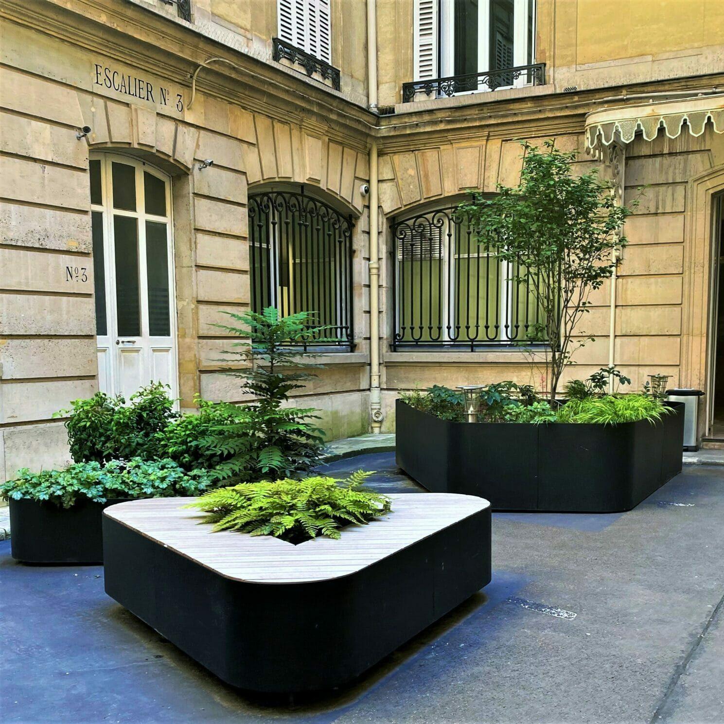 Bespoke triangular planter in painted aluminium and wood seats